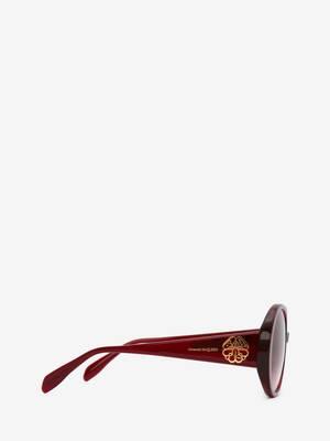 Runde Sonnenbrille mit Siegeldetail